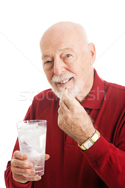 Senior Man Taking Fish Oil Capsule Stock photo © lisafx
