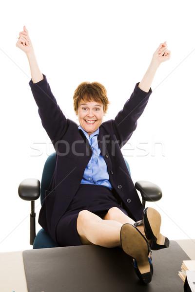 Businesswoman at desk - Overjoyed Stock photo © lisafx