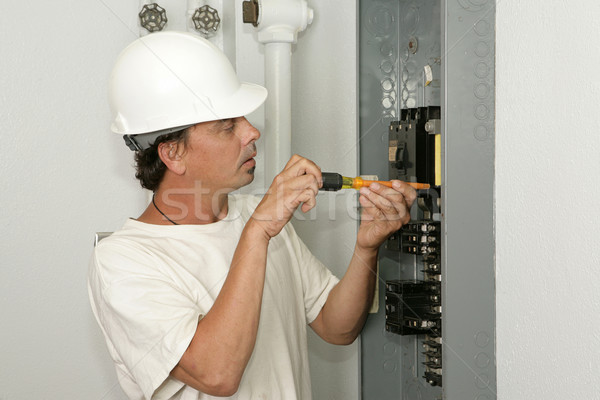Electrician Installing Breaker Stock photo © lisafx