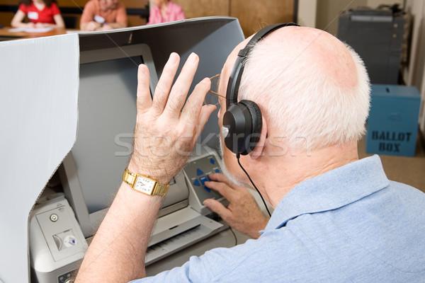 Senior Man Uses Touch Screen Stock photo © lisafx