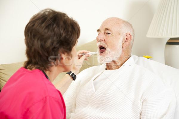 Otthon nővér hőmérséklet hőmérő elvesz idős Stock fotó © lisafx