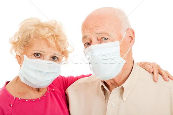 Járvány sertés influenza idősek idős pár visel Stock fotó © lisafx