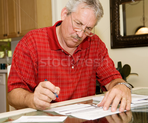 Mature Man Signing Papers Stock photo © lisafx