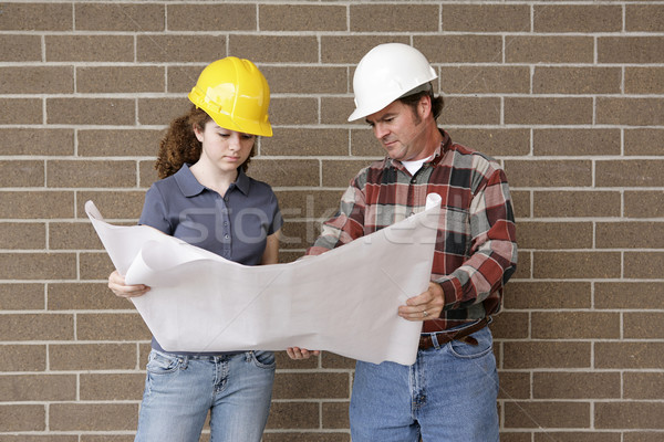 Stock photo: Construction Team with Blueprints