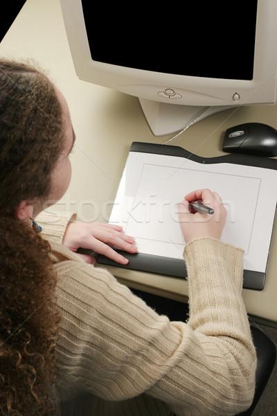 Grafik tablet dikey görmek kız çalışma Stok fotoğraf © lisafx