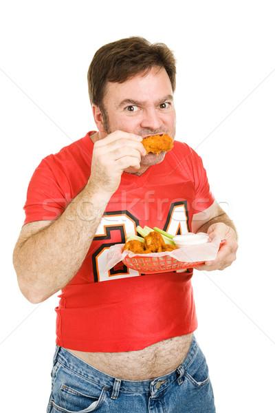 Ongezond stadion voedsel te zwaar strak Stockfoto © lisafx