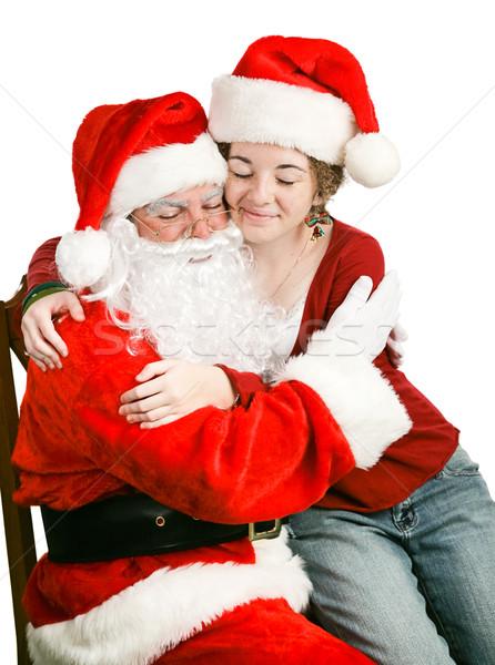 Girl Sitting on Santas Lap Getting a Hug Stock photo © lisafx