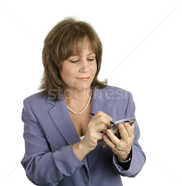 Businesswoman Checking Her PDA Stock photo © lisafx