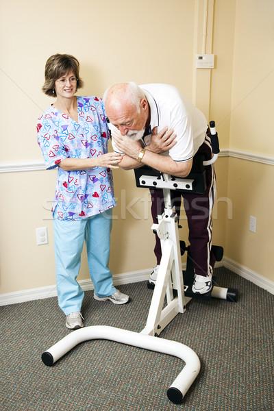 Senior Man Does Spine Stretch Stock photo © lisafx