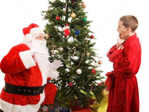 Santa Surprised by Child Stock photo © lisafx