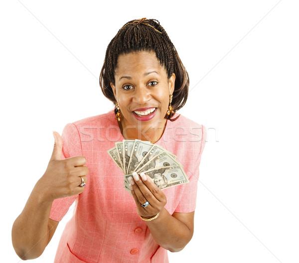 Woman Holds Cash - Thumbsup Stock photo © lisafx