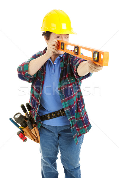 Stock photo: Female Worker Using Level