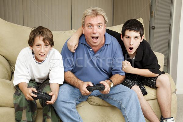 Család játék éjszaka nagybácsi játszik videojátékok Stock fotó © lisafx