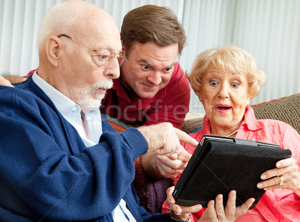 Seniors and Adult Son with Tablet PC Stock photo © lisafx