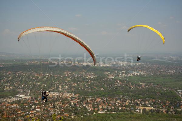 Siklórepülés kettő repülés város sportok jókedv Stock fotó © LIstvan