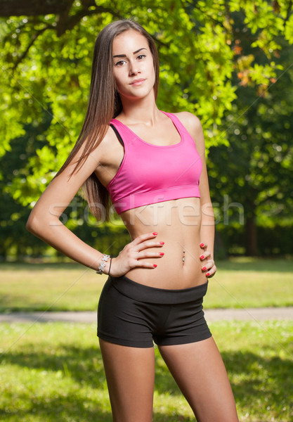 Beautiful slender young fitness girl. Stock photo © lithian