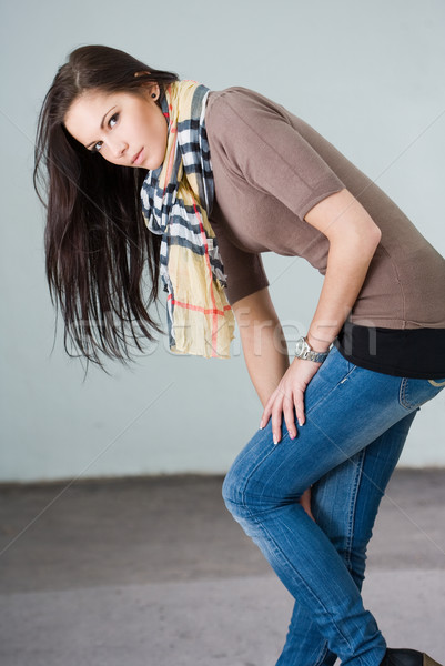 Beautiful young brunette modeling jeans Stock photo © lithian