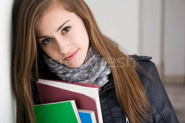 Shy young brunette student girl. Stock photo © lithian