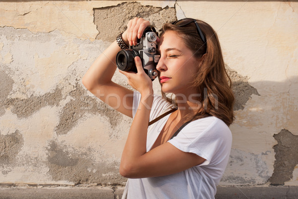 Young woman taking photos Stock photo © lithian