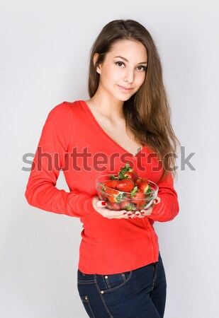 Cute thoughtful brunette with strawberries. Stock photo © lithian
