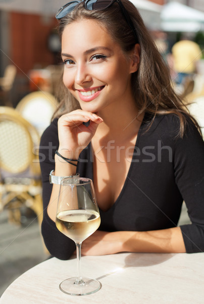 Stock photo: Brunette beauty having wine fun.