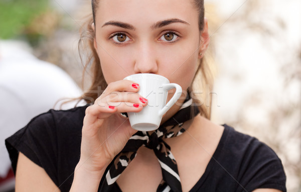 Brunette beauty drinking espresso. Stock photo © lithian