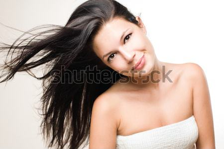 Beauty shot of brunette with flowing hair. Stock photo © lithian