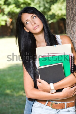 Thoughtful young student girl. Stock photo © lithian