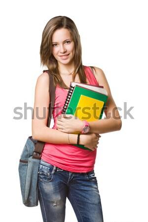 Derűs fiatal diák testmozgás könyvek izolált Stock fotó © lithian