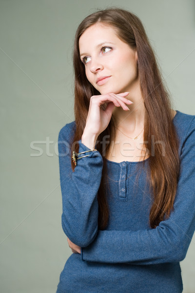 Pretty young student girl pondering. Stock photo © lithian