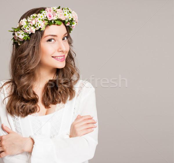 Gorgeous brunette woman wearing spring flower wreath. Stock photo © lithian
