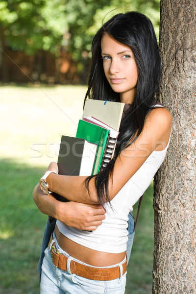 Attractive slender young student girl in the park. Stock photo © lithian