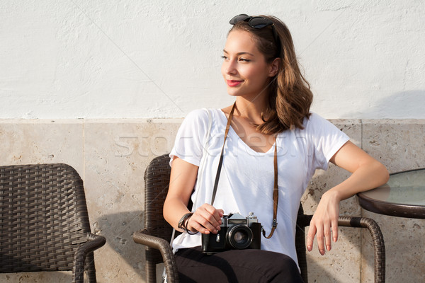 Brunette beauty taking photos. Stock photo © lithian