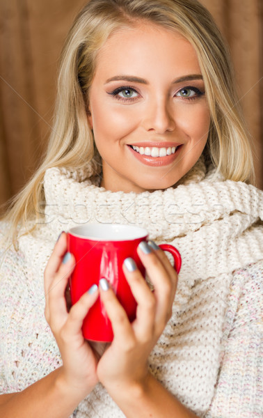 Young blond with hot beverage. Stock photo © lithian