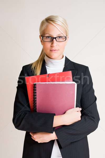 Tense looking young business woman. Stock photo © lithian