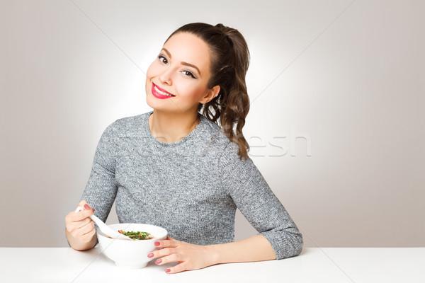 Bruna bellezza ritratto mangiare donna Foto d'archivio © lithian