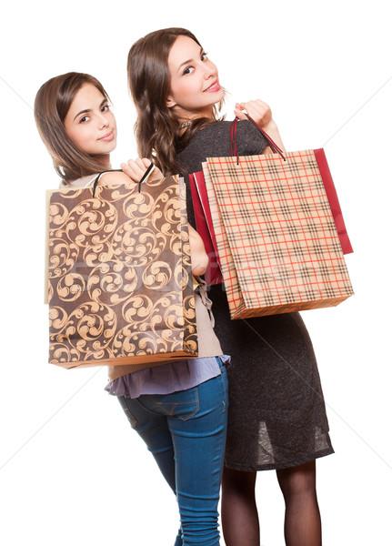 Vásárlás jókedv pár barna hajú nő város Stock fotó © lithian