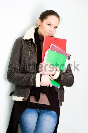 Confident young brunette college girl. Stock photo © lithian