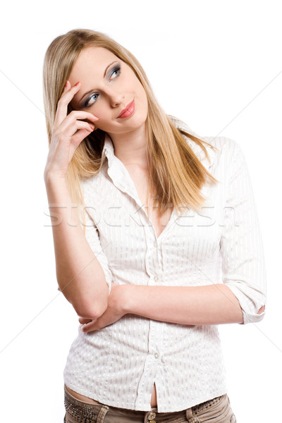 Beautiful young blond woman pondering. Stock photo © lithian