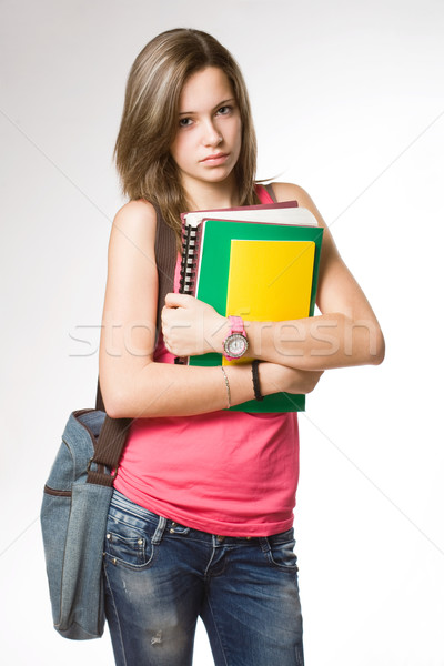 Angry, frustrated looking young student girl. Stock photo © lithian