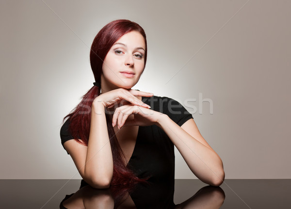 Redhead beauty with strong facial expression. Stock photo © lithian