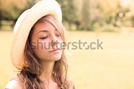 Gyönyörű nyugodt fiatal tavasz barna hajú kint Stock fotó © lithian