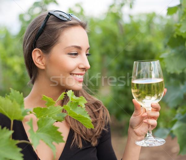 Stock photo: Wine tasting tourist woman.