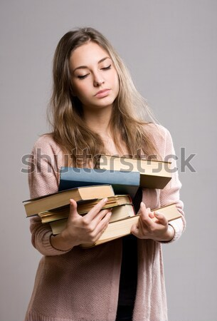 Stressed looking young student woman. Stock photo © lithian