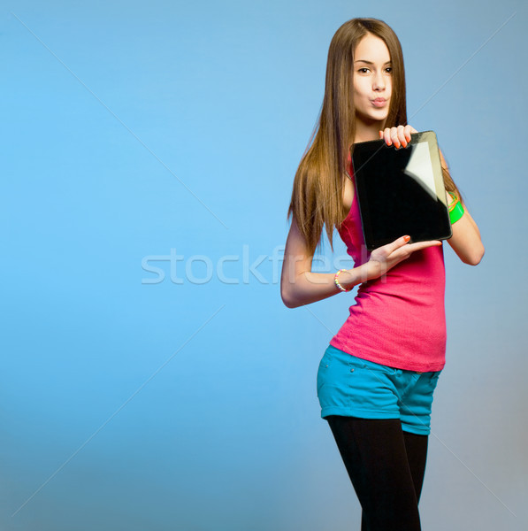 Teen cutie with tablet for copy space. Stock photo © lithian