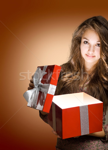 Young brunette with big red gift box. Stock photo © lithian