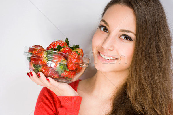 Gorgeous young woman with strawberries. Stock photo © lithian