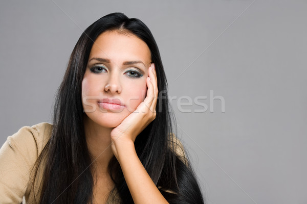 Thoughtful young brunette beauty. Stock photo © lithian