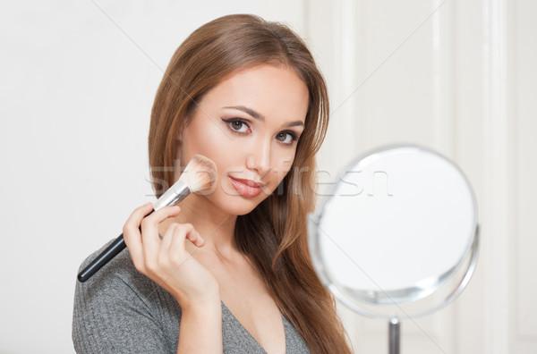 Stock photo: Elegant makeup for brunette beauty.