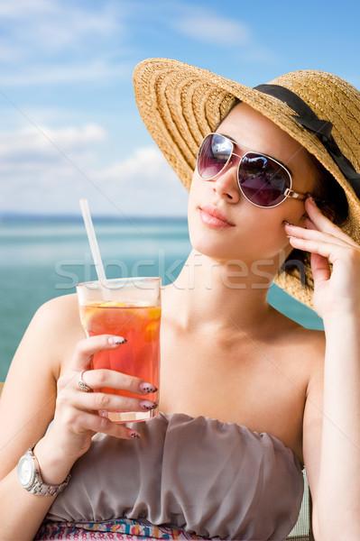 Genç esmer rahatlatıcı plaj güneşli portre Stok fotoğraf © lithian